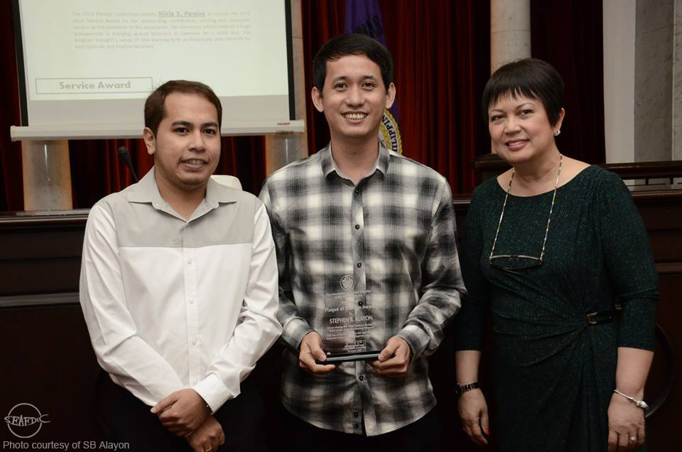 AQD librarian Mr. Stephen Alayon (center) with ASLP president Mr. Joseph Yap and PLAI president Ms. Elizabeth Peralejo