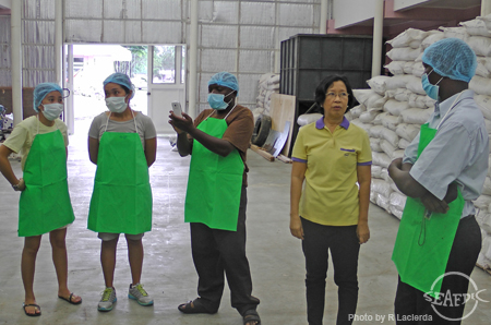 At AQD's pilot-scale feed mill with AQD scientist Dr. Veronica Alava (in yellow)