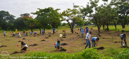 AQD employees at the tree planting area