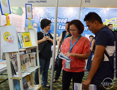 Ms. Grace Garcia entertains a visitor at the AQD booth