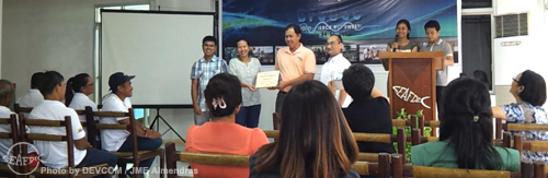 BFS driver Mr. Nestor Dela Cruz (2nd from right) receives a Certificate of Recognition for his exemplary and loyal service to the research station from (L-R) Dr. Frolan Aya, Dr. Ma. Junemie Hazel Lebata-Ramos and Dr. Takuro Shibuno