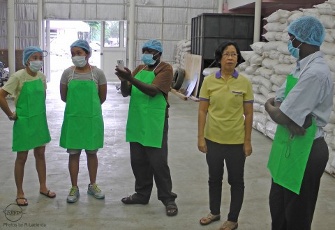 "Trainees for ""aquafeed formulation & preparation"" course at AQD's pilot-scale feed mill with AQD scientist Dr. Veronica Alava (in yellow)"