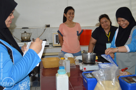 "BE HAPPY! Trainees share a good laugh while doing feed preparation for ""ulang"""