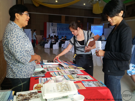 Ms Jasmine Junk (M) Program Specialist of USDA Foreign Agricultural Service and Ms Ingrid Ardjosoediro (R) Senior Analyst, Food Assistance Division of USDA browsing through AQD's bookstall manned by  SEAFDEC/AQD's Information Officer, Ms. Ruby F. Bombeo (L)