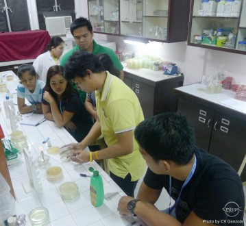 Senior technical assistant Mr. Demy Catedral assists the participants during their practicals on pathogenicity test