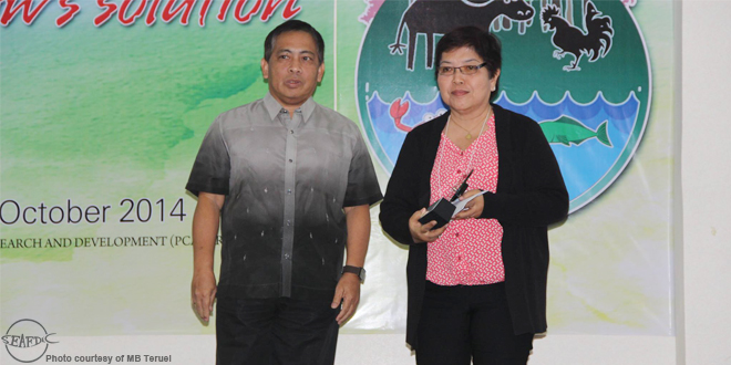 Dr. Myrna Bautista-Teruel receiving the award from Dr. Danilo Cardenas, Deputy Executive Director for Administration and Resource Management of PCAARRD, during the National Symposium on Agriculture, Aquatic Resources Research and Development (NSAARRD) and Dr. Elvira O. Tan Memorial Awards for Outstanding Fisheries Publication
