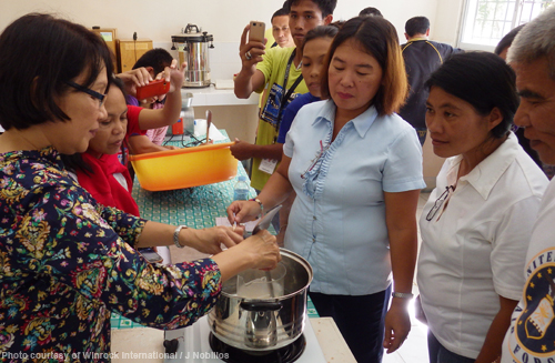 SEAFDEC/AQD scientist Dr. Mae Catacutan teaches the participants how to process feeds