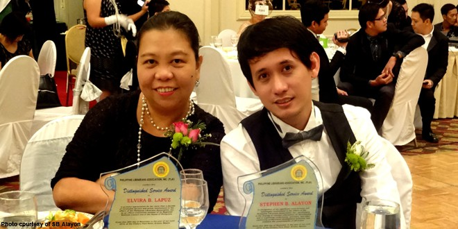 SEAFDEC/AQD Library Head Mr. Stephen Alayon with fellow awardee Ms. Elvira Lapuz. Both awardees  were elected executive vice president and president, respectively, of the PLAI National Board of Trustees for 2015-2016