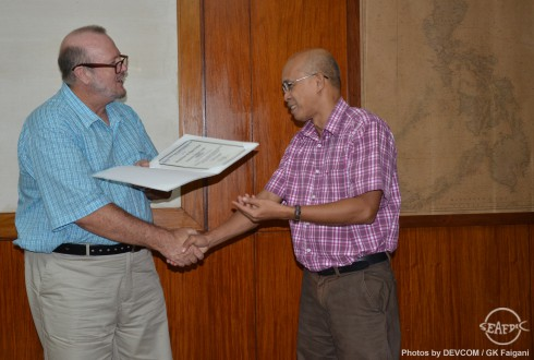 Prof. Knibb receives a certificate of appreciation from AQD Chief Dr. Felix Ayson