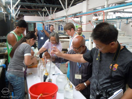 AQD researcher Ms. Milagros dela Peña supervises the trainees during their practical on phytoplankton culture