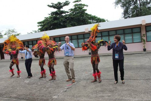 "The delegates dancing the ""sadsad"" or  festival street dancing together with some of the warrior/dancers of ""Tribu Panayanon"" of Iloilo City National High School, the 2015 Dinagyang Champion"