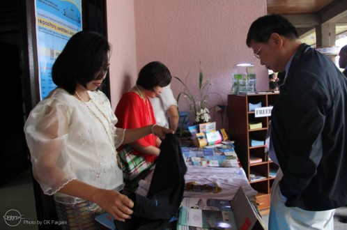 AQD bookstore staff selling manuals and souvenirs to APEC delegates