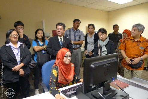 One of the staff of the National library shows the participants how they digitalized the old manuscript