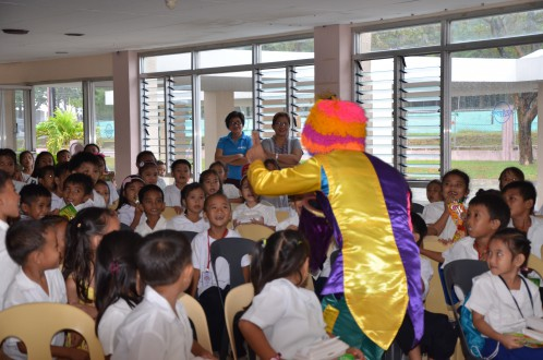 The children were entertain by a clown during the magic show