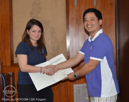 Ms. Duncan receives her certificate of appreciation from SEAFDEC/AQD Associate Scientist Dr. Jon Altamirano