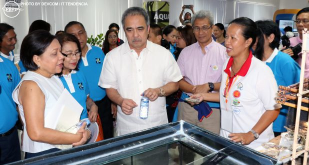 Training and Information Head Dr. MJHL Ramos showing AQD's oysters set-up to Senator Cynthia Villar