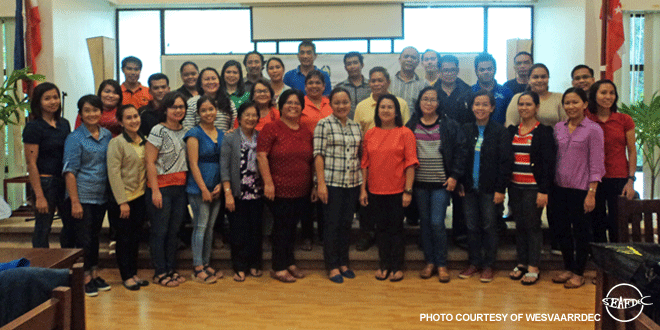 ATI's Ms. Antonieta Arceo (middle, in white) with the IEC materials development training participants