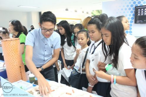 SEAFDEC/AQD's Research assistant Mr. Jonas Mediavilla explains to students the abalone culture experimental set-up in a reef flat using PVC pipes