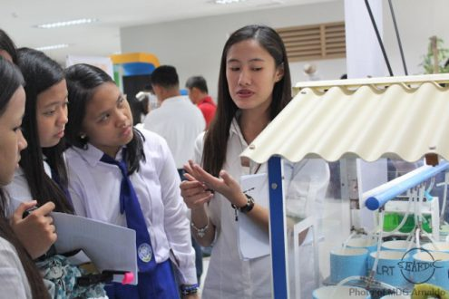 SEAFDEC/AQD's Research assistant Ms. Valerie Lorraine Tan explains to the students the experimental set-up of the oyster project