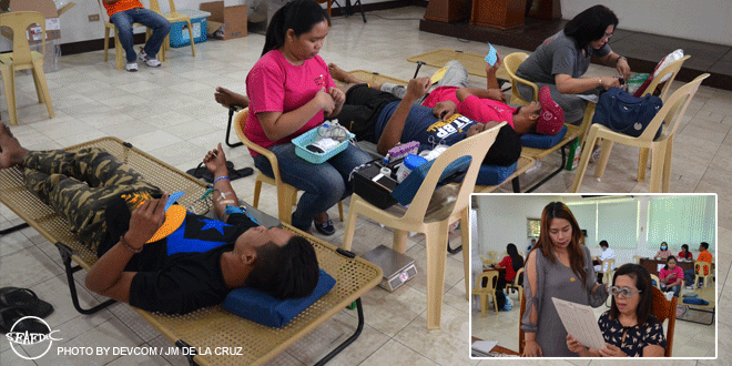 Philippine Red Cross –Western Visayas Chapter team facilitates bloodletting and (inset) Dr. Effie Pineda of E. Pineda Optical Clinic giving eye exams to SEAFDEC/AQD staff