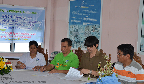 (L-R) Ms. Julieta Gabayeon, Technical Services Division Chief of DENR Guimaras; Mr. Vicente Sardina, OIC of DENR-PENRO Guimaras; Dr. Chihaya Nakayasu, Acting Chief and Deputy Chief of SEAFDEC/AQD; and Mr. Mateo Paquito Yap, OIC of SEAFDEC/AQD'sIgang Marine Station during the MOA signing